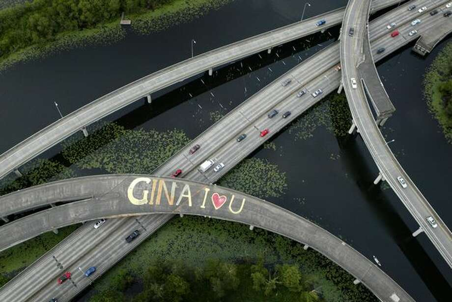 "Unknown to motorists below, a message of love to an unknown ""Gina"" was scrawled across the lanes of an overpass on state Route 520 in the Arboretum on June 12, 2007. ""Gina"" was never identified. (Joshua Trujillo/Seattlepi.com file) Photo: P-I File"