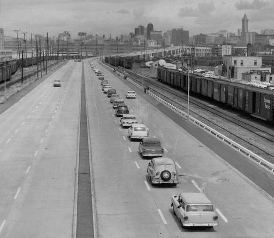 The Sept. 1959 photo caption read: A single lane of cars moves north on the Spokane Street extension of the Alaskan Way Viaduct yesterday after dedication ceremonies. Photo: P-I File
