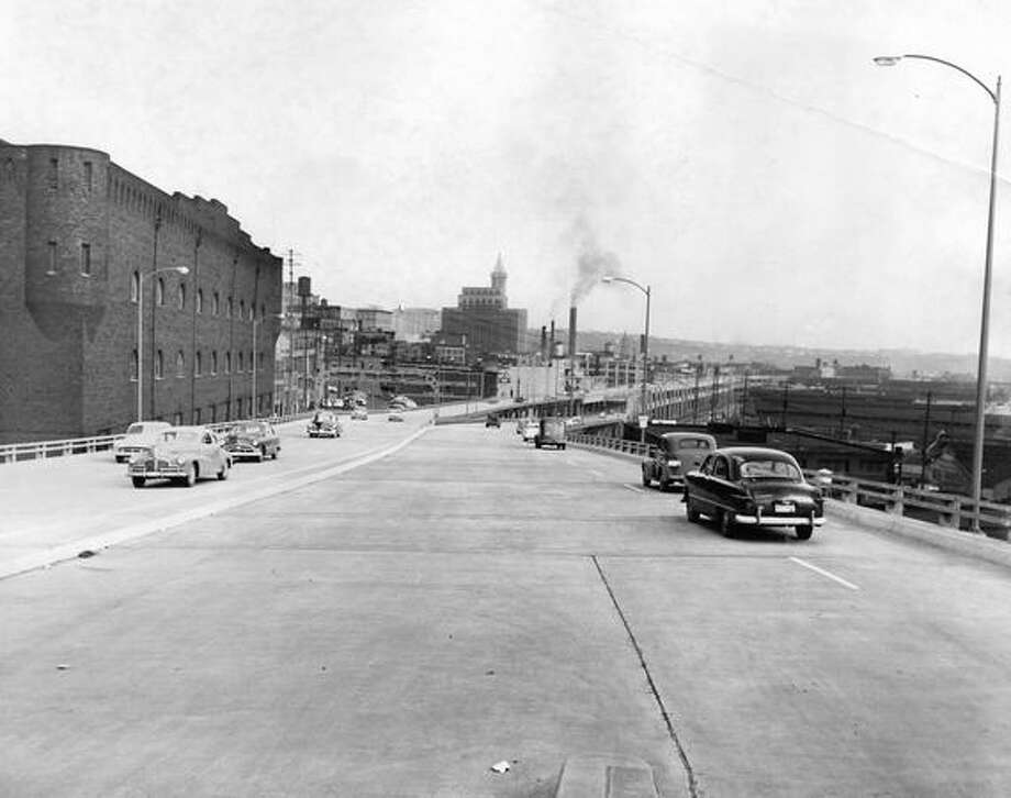 The April 6, 1953 photo caption read: The Alaskan Way Viaduct at 4:45 p.m. on first day of regular operation. Photo: P-I File