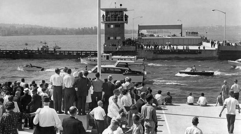 Looking west on 520 bridge, spectators watch boats parade through open drawspan, August 1968. Photo: P-I File