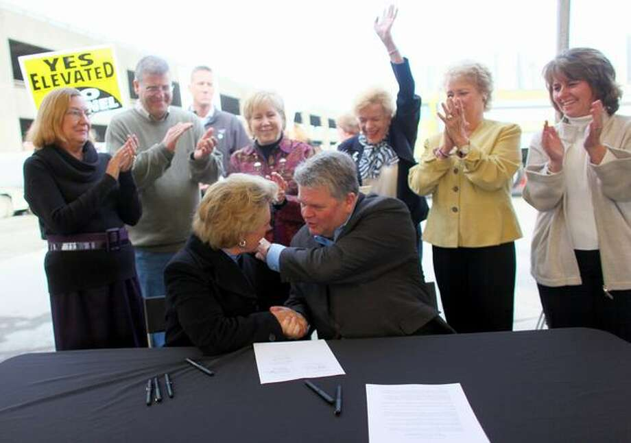 "The October 2009 photo caption read: Members of the Seattle City Council and Washington state legislators applaud as Seattle Mayor Greg Nickels and Gov. Chris Gregoire sign a memorandum to replace the waterfront viaduct. A deep-bored tunnel is planned to replace the aging structure, a central issue in Seattle's upcoming mayoral election. Nickels, who was defeated in the primary, said some issues are worth losing an election over. ""This is one of them,"" he said. Photo: P-I File"