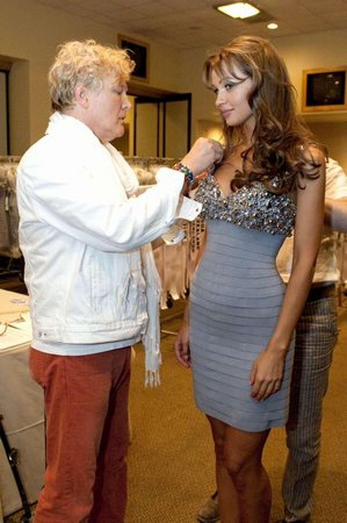 Costumer David Profeta fits Anna Poslavska, Miss Ukraine 2010, in a Sherri Hill dress as she starts the registration and fitting process in preparation for the Miss Universe 2010 competition at Mandalay Bay Hotel and Casino in Las Vegas on Saturday, Aug. 7, 2010. Eighty-three contestants, who began arriving in Las Vegas on Saturday, will spend the next two weeks attending civic events and preparing for the finals, at which a new Miss Universe will be crowned on Aug. 23.