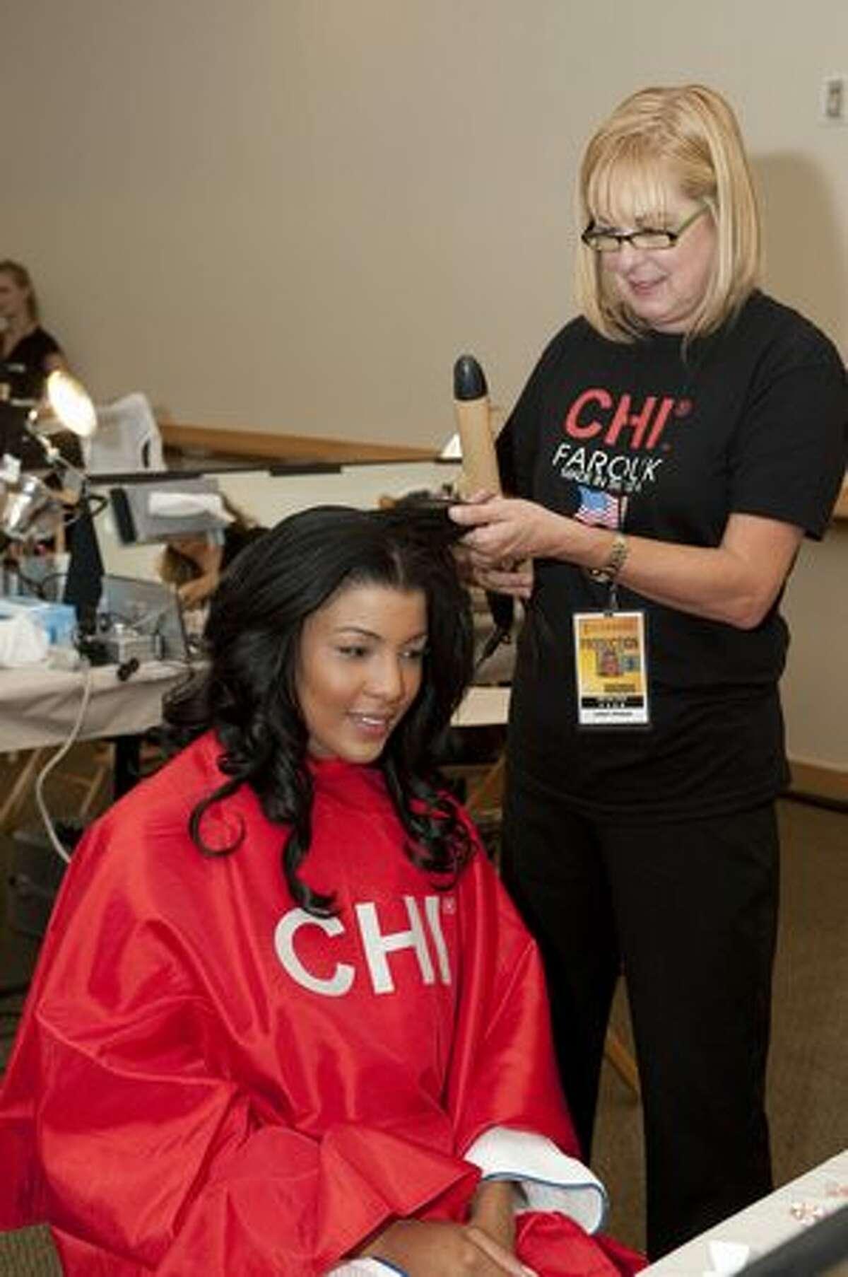 Sarodj Bertin, Miss Haiti 2010, has her hair done by Chi Hair Stylist Cindy Ryman.