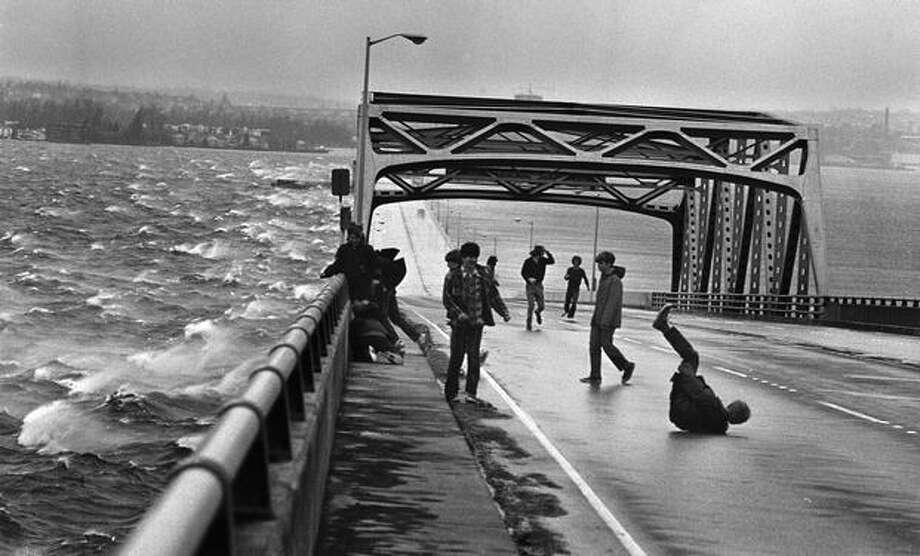 Teenagers having fun on the 520 bridge after his was closed for high winds, March 1971. Photo: P-I File