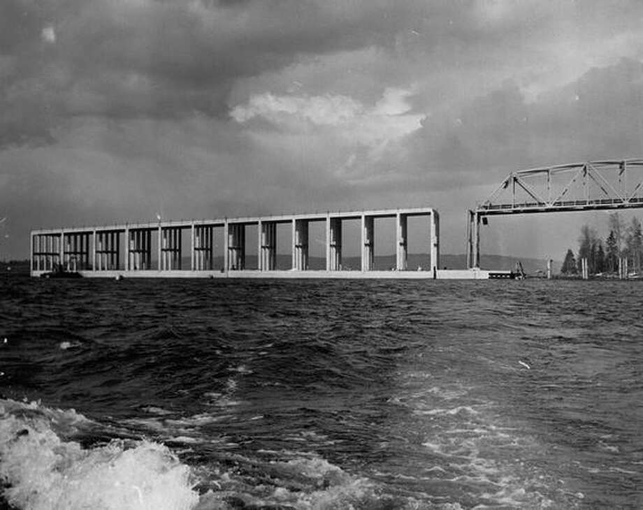 The March 1963 photo caption read: New pontoon section in place at Evergreen Point Floating Bridge. Photo: P-I File