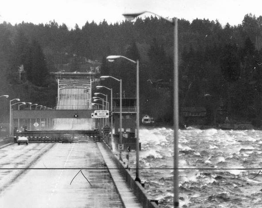 The January 1974 photo caption read: At least 80,000 drivers were diverted from the Evergreen Point Floating Bridge yesterday as the span was closed for the second day in succession due to high winds and waves. Photo: P-I File