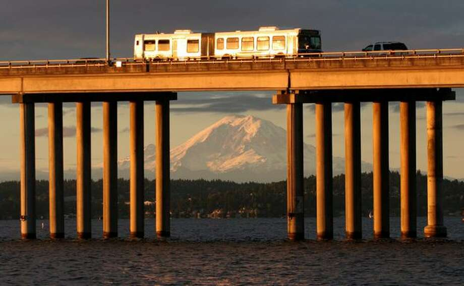 Mt. Rainier can be seen through the support columns of the 520 bridge, August 2006. Photo: P-I File