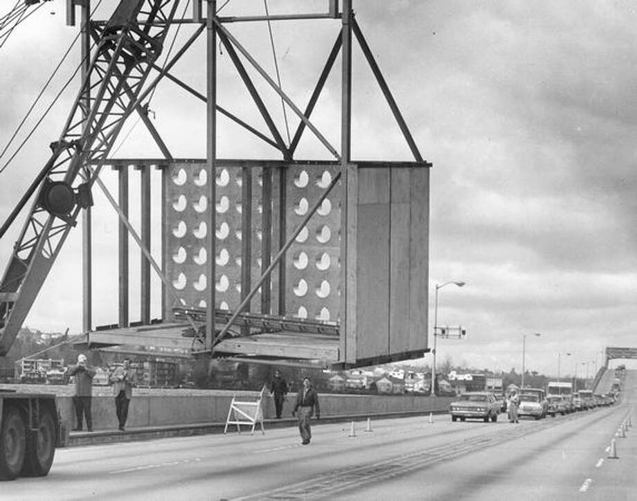The March 1971 photo caption read: An attenuator was maneuvered into position. Photo: P-I File