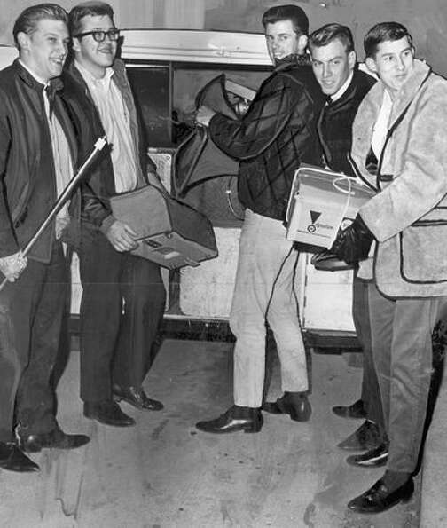 The Kingsmen load their instruments into a trailer after a Seattle recording session, January 1964.
