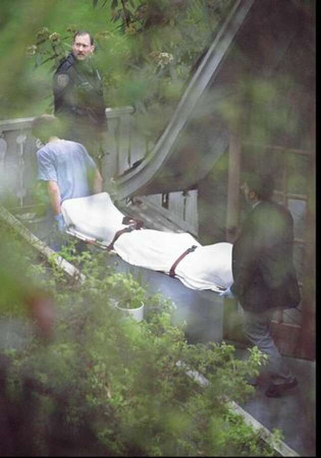 Kurt Cobain being moved from the home where he was found dead, April 8, 1994. Click here to download the Seattle police report. (Mike Urban/Seattlepi.com file) Photo: P-I File