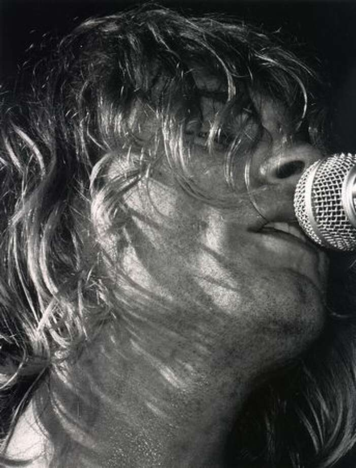 Kurt Cobain sings during Nirvana's concert at the Paramount, Oct. 31, 1991. Photo: P-I File