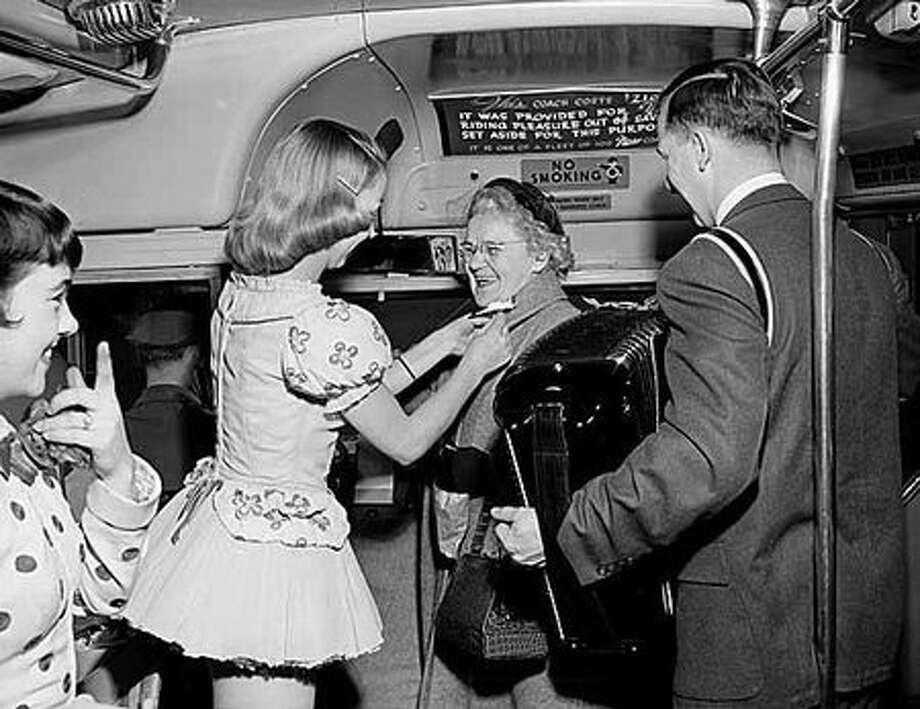 Stan Boreson plays his accordian in a 1956 celebration of no-fare bus routes. (Seattlepi.com file/MOHAI) Photo: P-I File