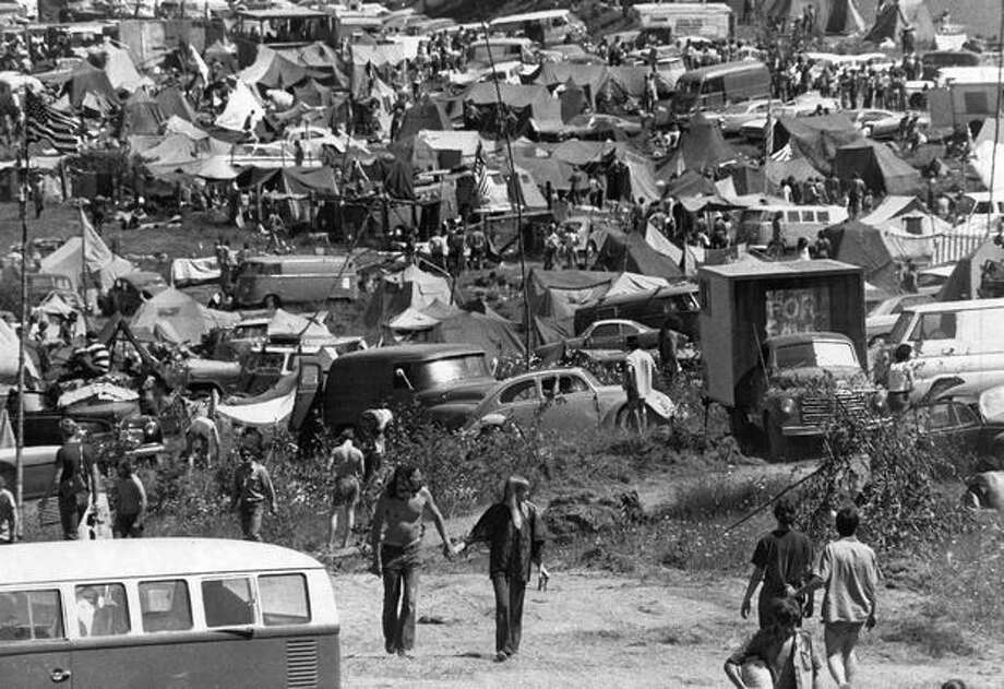A jumble of people, tents and cars at a rock festival on the Flying-M Ranch near Eatonville, July 5, 1970. (Cary Tolman/Seattlepi.com file) Photo: P-I File