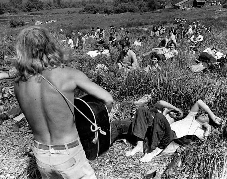 Guitarist Steve Winkler of Seattle entertains listeners at the Sunrise to Sunset rock festival near Duvall, June 1, 1969. Photo: P-I File