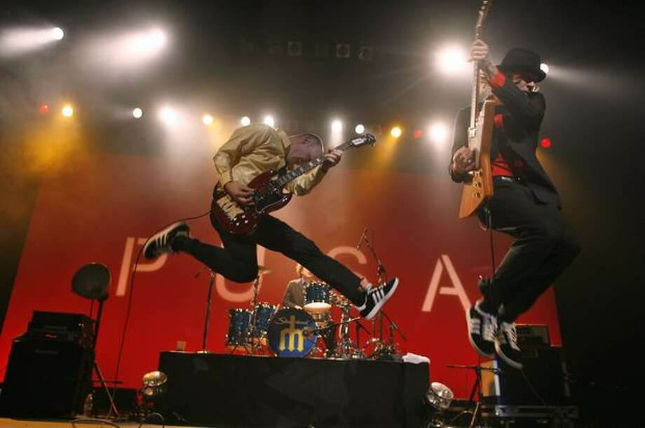 Chris Ballew and Andrew McKey of The Presidents of the United States of America leap around the stage as they play the Paramount Theater, Feb. 15, 2008. (Mike Urban/Seattlepi.com file) Photo: P-I File