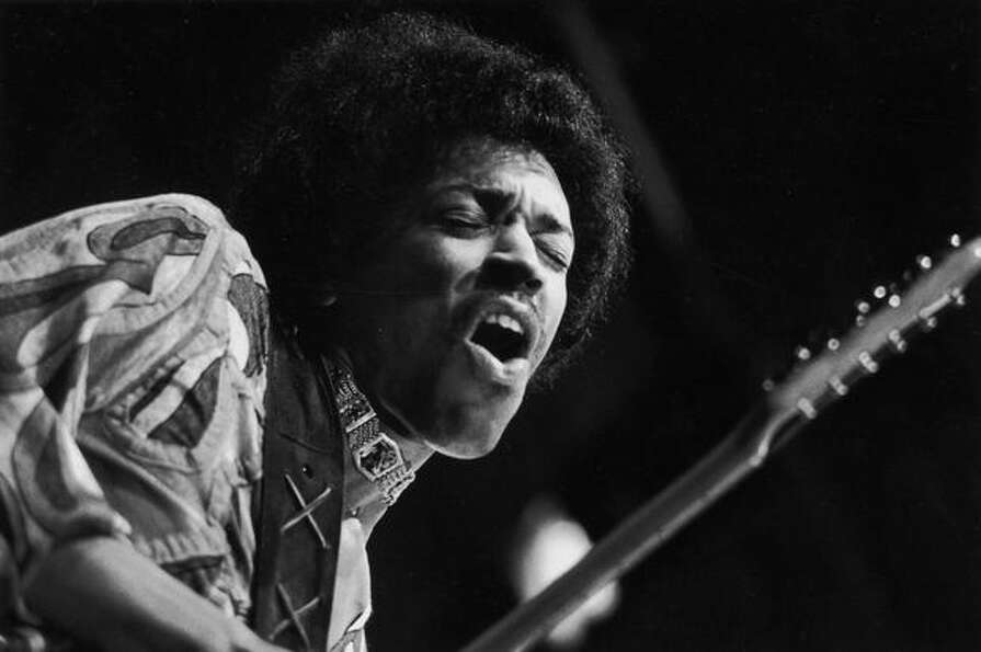 Seattle native Jimi Hendrix caught mid guitar-break during his performance at the Isle of Wight Fest
