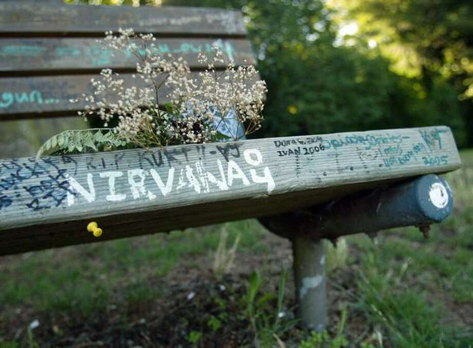 The bench next to the home where Kurt Cobain commited suicide has become a place for fans to leave messages. It's shown here in 2007. Photo: P-I File