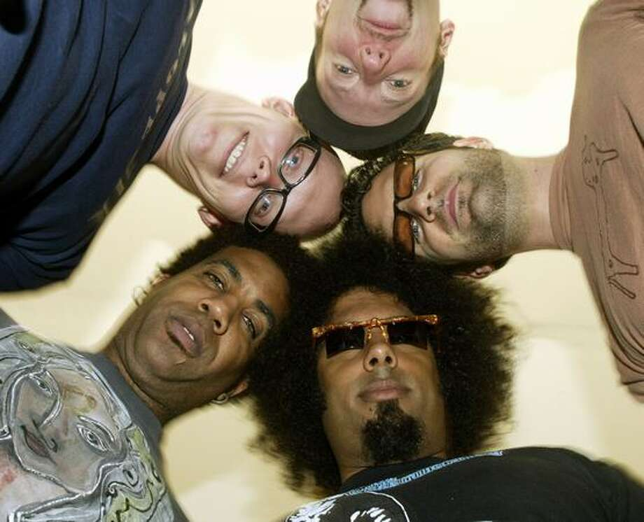 Members of the Seattle Maktub, clockwise from top, drummer Davis Martin, bassist Kevin Goldman, lead singer Reggie Watts, guitarist Thaddeus Turner, and keyboardist Daniel Spills, in 2003. Photo: P-I File