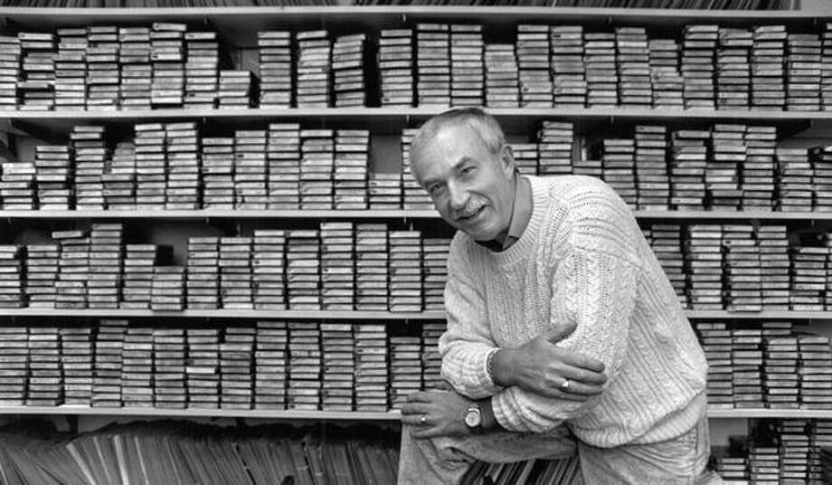 Legendary Seattle DJ Dick Curtis with his show archive in 1990. Curtis was among the KJR DJs who dominated 1960s airwaves in Seattle. Photo: P-I File