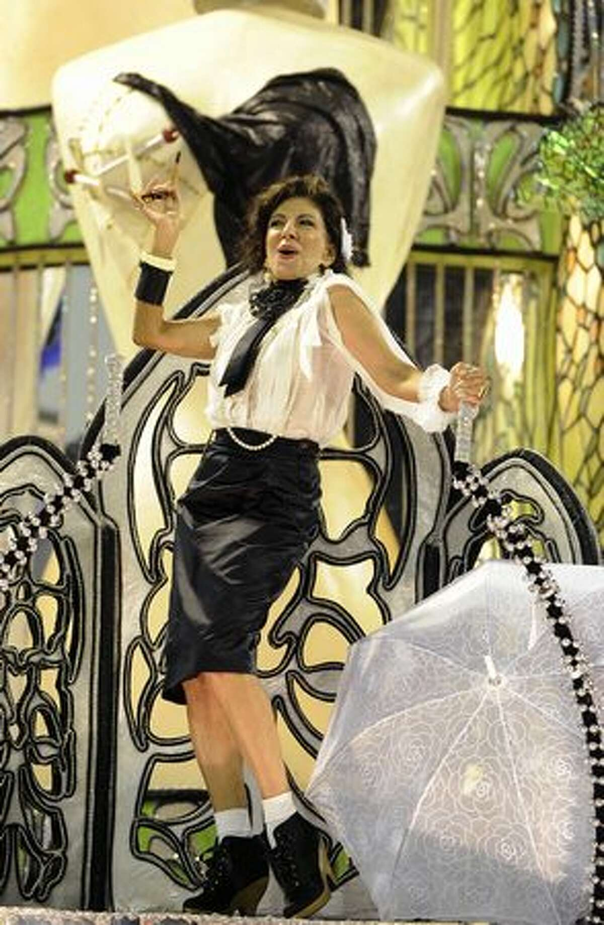 Brazilian actress Marilia Pera represents French stylist Coco Chanel over a float of the samba school Porto da Pedra as part of their theme