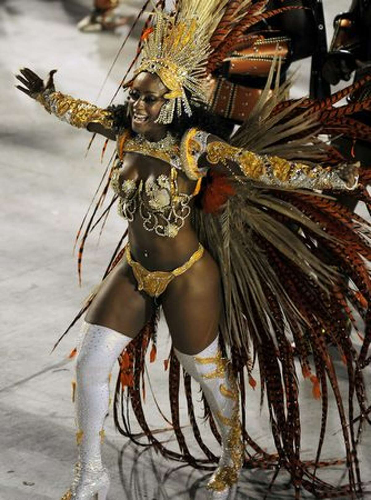 A reveller of the samba school Portela performs during the second night of Rio's famed Carnival, at the Sambodrome in Rio de Janeiro, Brazil.