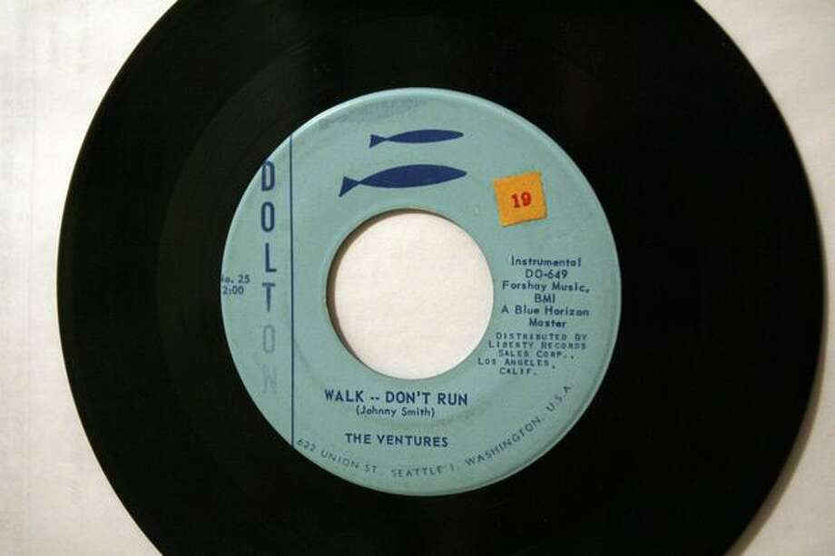 "A Dolton Records copy of The Ventures' ""Walk Don't Run"" from 1960. The song was first released on Blue Horizon records. Photo: Casey McNerthney, Seattlepi.com"