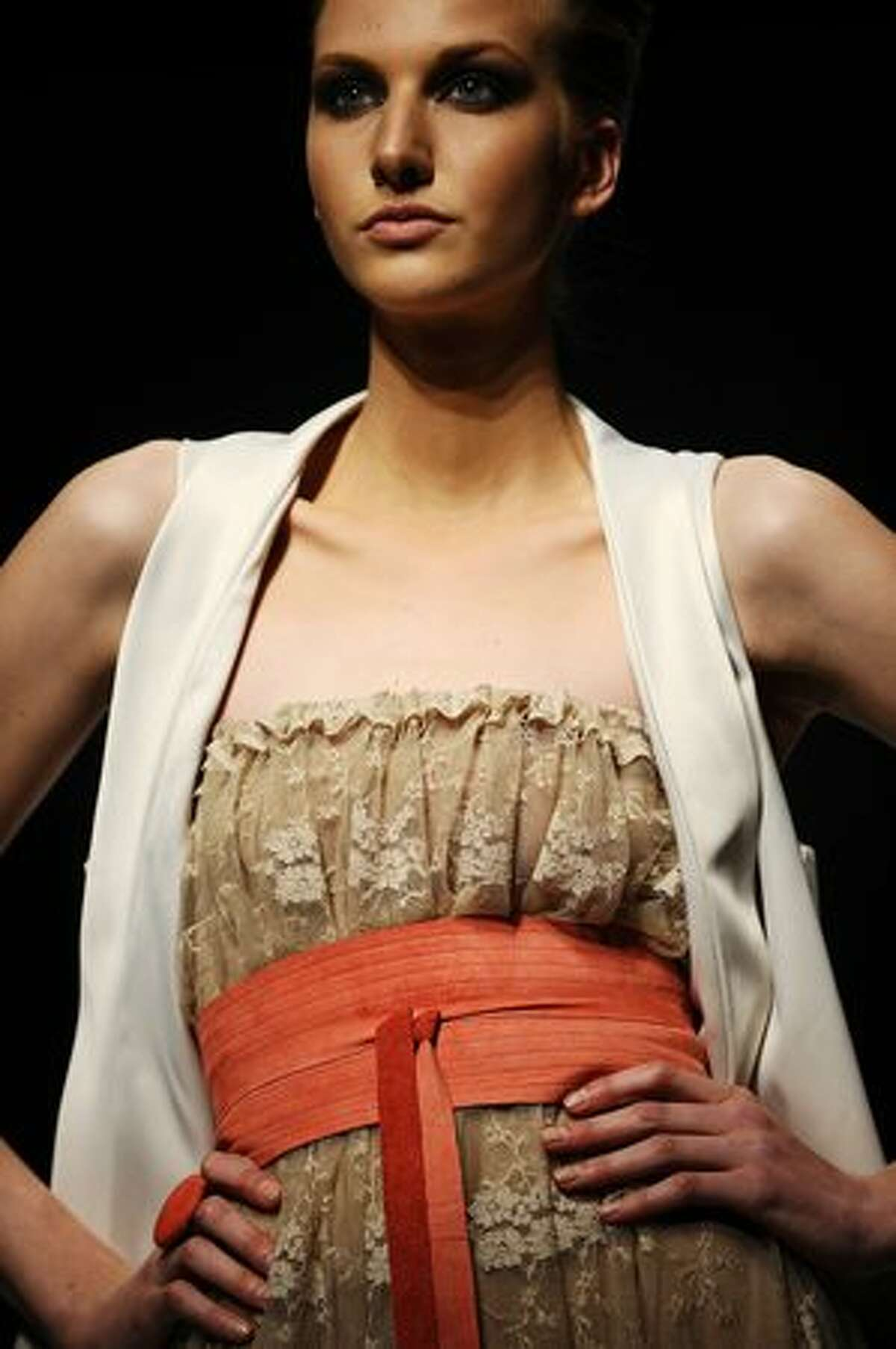 A model showcases a creation by designer
