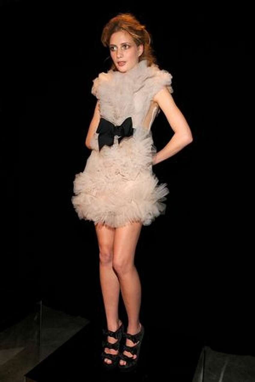 A model poses at the Marchesa Fall 2010 Presentation during Mercedes-Benz Fashion Week at the Chelsea Art Museum in New York on Wednesday, Feb. 17, 2010.