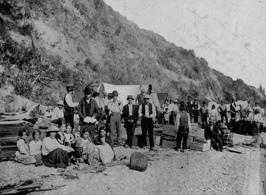 The photo caption indicates this photo shows Native Americans near what's now Belltown. Date unknown. [This caption has been charged from the original caption, copied from the original P-I photo.] Photo: P-I File