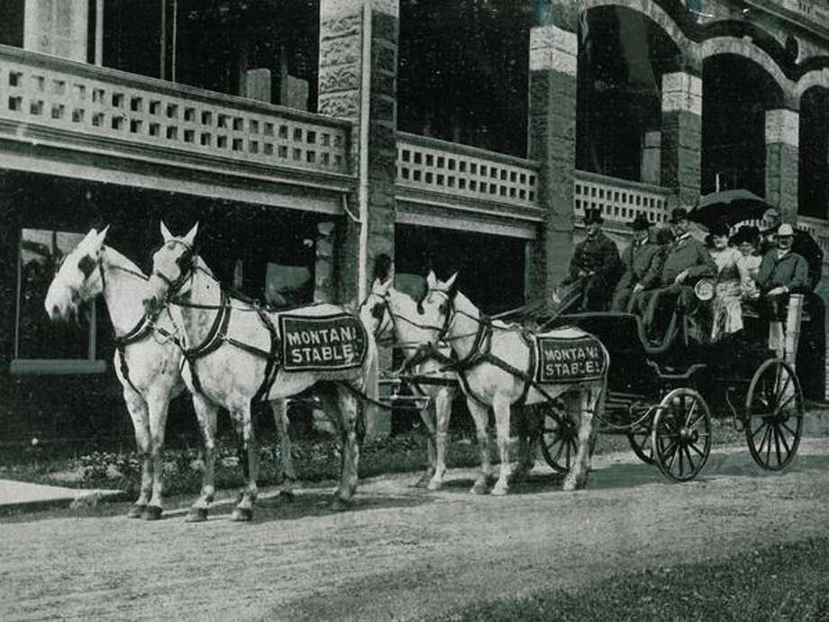 "The photo caption reads: Four handsome white horses pull one of Seattle's earliest ""taxicabs"" for a hack service operated by the Montana Stables which was located at 4th Ave. S. and Washington St. The stables were close to the depot, to meet trains and whisk the passengers to the hotels. This service flourished around 1904. Photo: P-I File"