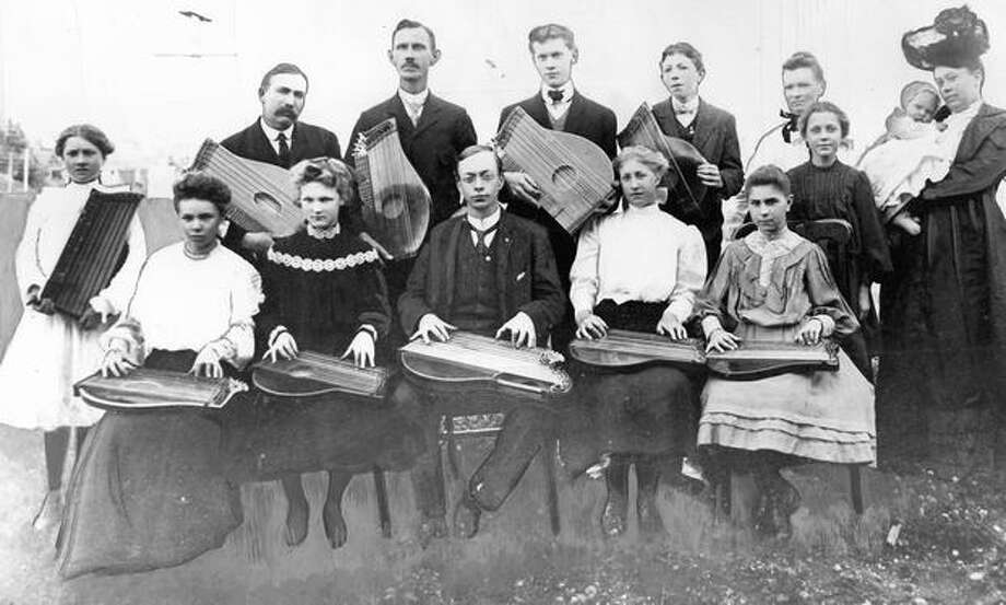 The caption to this 1905 photo caption reads: Here is what surely was the first zither orchestra in Seattle. The picture was taken at 115 Mercer Street. Photo: P-I File