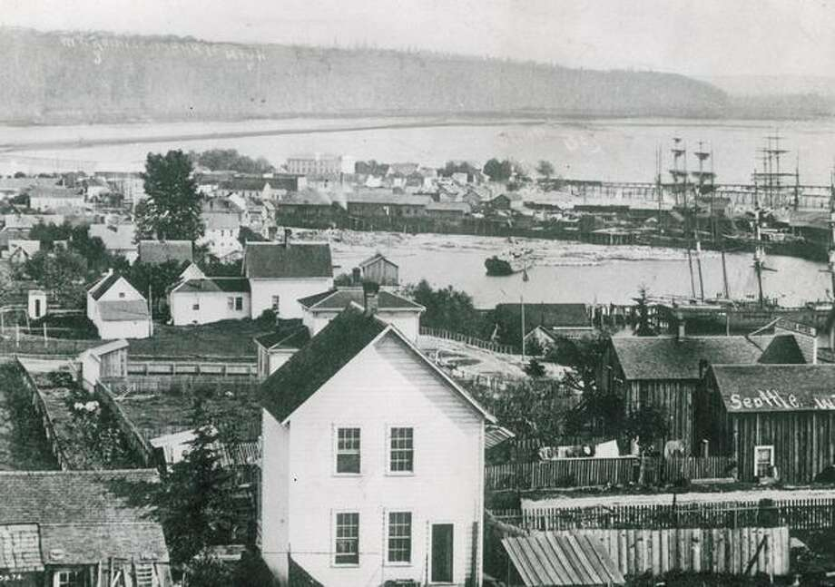 The caption for this 1878 photo reads: Between First and Second Avenues and Pike Street, looking south. Photo: P-I File