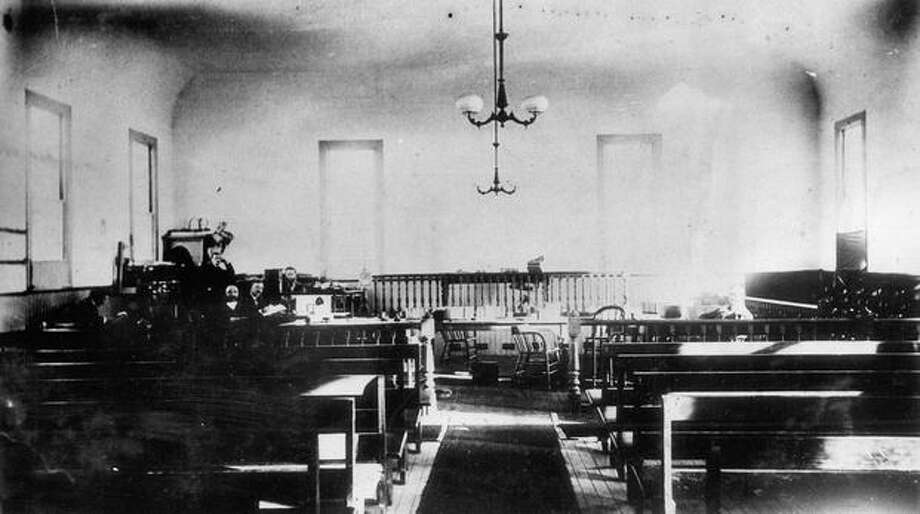 The caption for this photo reads: A view of the Court room, taken about 1885 by Colonel J.C. Haines. Photo: P-I File