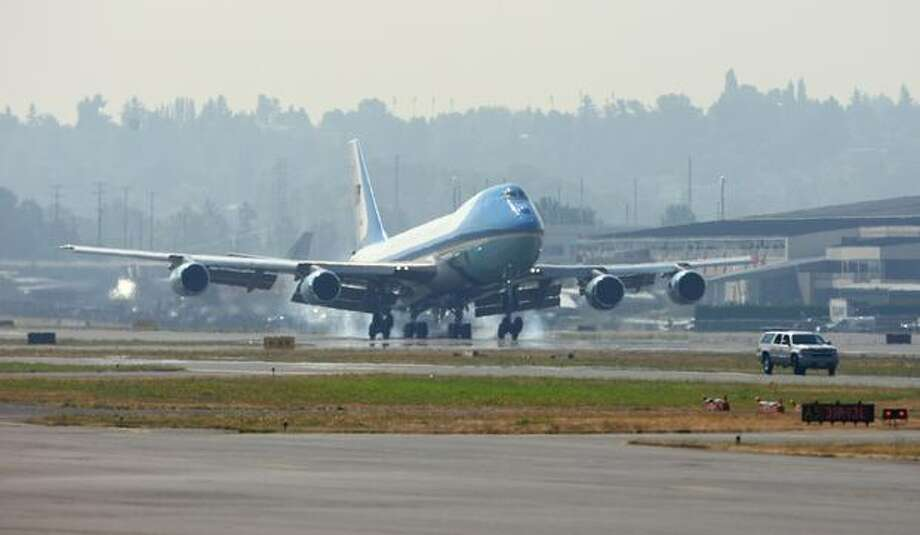 Air Force One lands at Boeing Field in Seattle as U.S. President Barack Obama arrives for a fundraising event in Seattle. Photo: Joshua Trujillo, Seattlepi.com