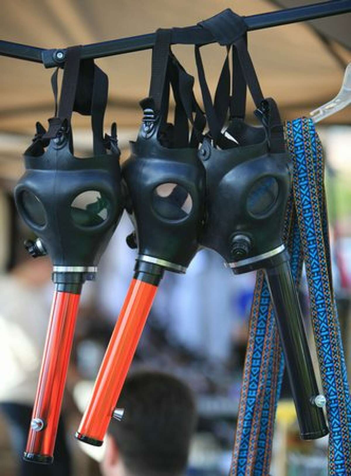 Gas masks are for sale during Seattle's Hempfest at Myrtle Edwards Park.