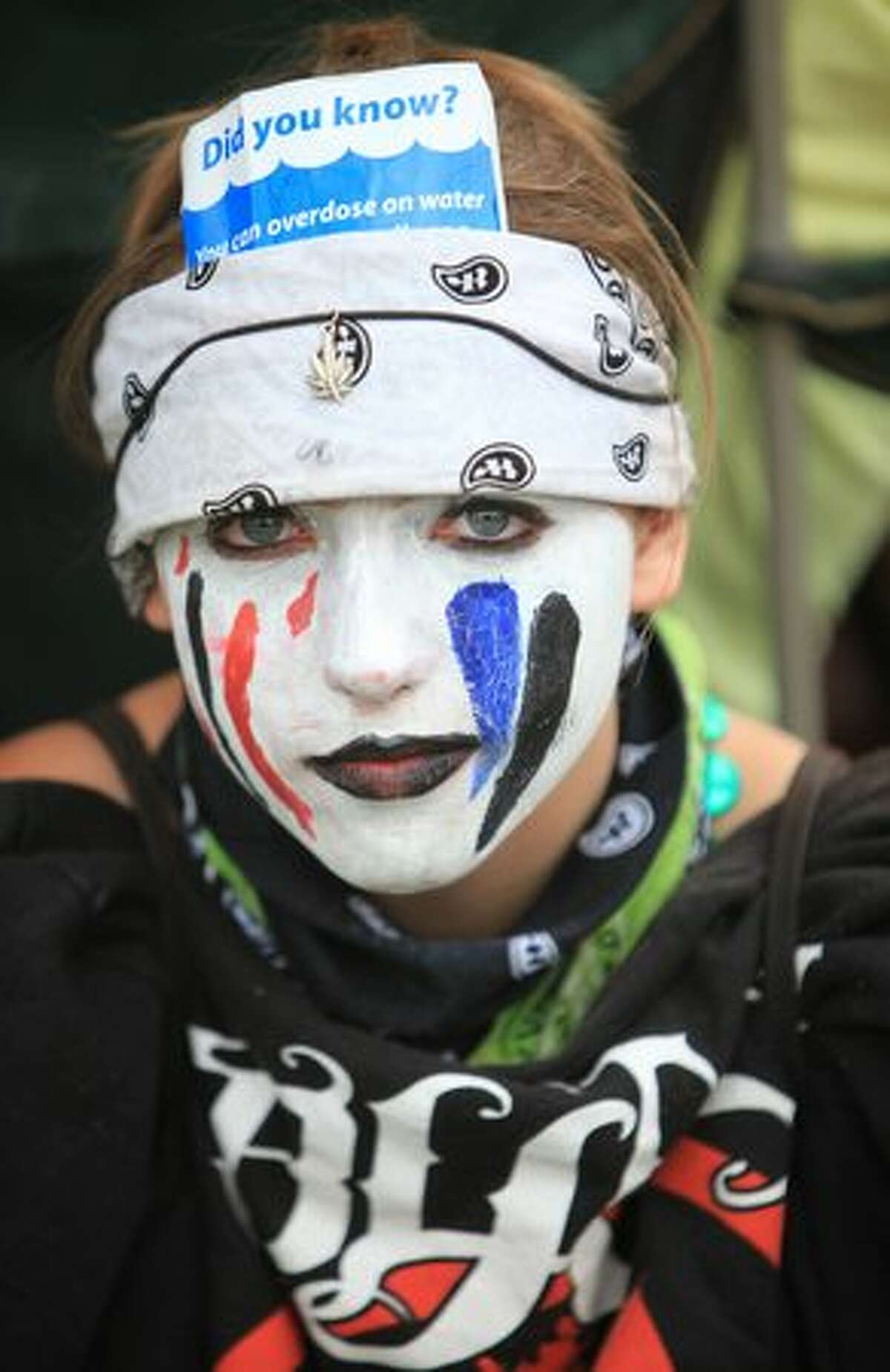 Kindra DePoppe shows her face paint during Seattle's Hempfest.