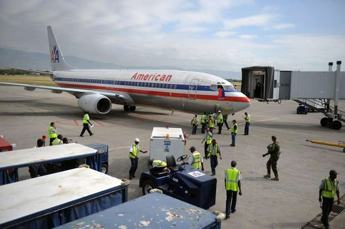 An American Airlines flight coming from Miami is seen upon arrival to Port-au-Prince's international airport on Feb. 19, 2010. The first passenger plane to arrive in Haiti since the Jan. 12 earthquake touched down in Port-au-Prince to a warm welcome Friday, but with many passengers carrying a heavy emotional load.