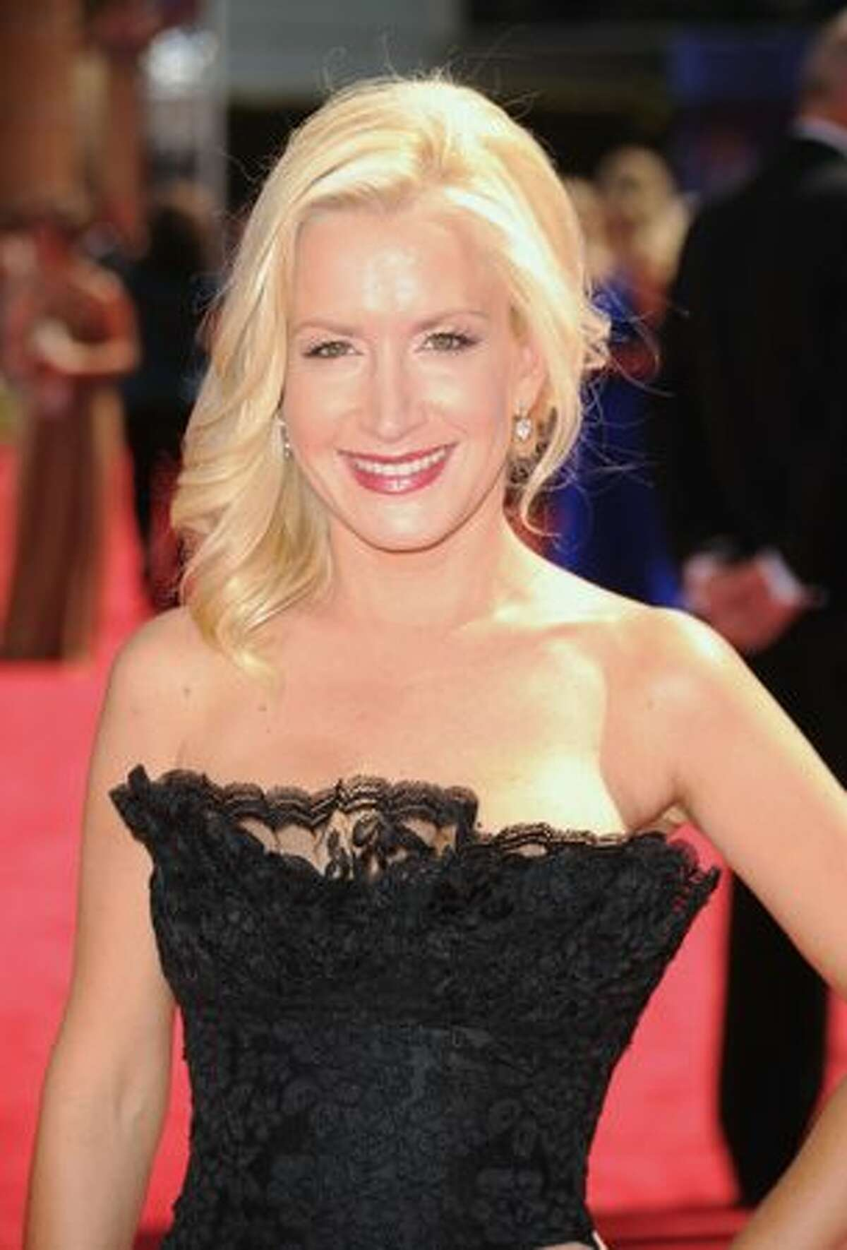 Actress Angela Kinsey arrives.
