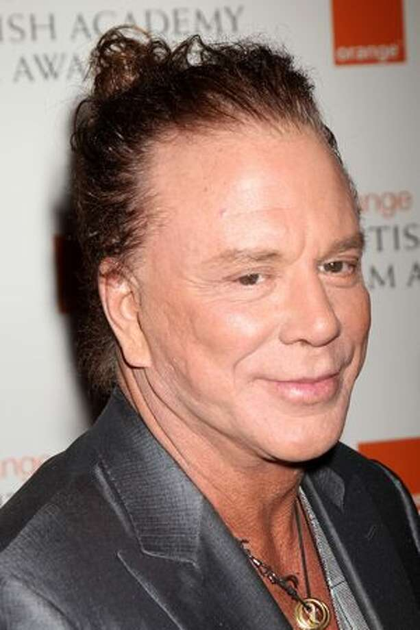 Mickey Rourke says his face was messed up by boxing, but the plastic surgery he had didn't really fix it.  Photo: Getty Images