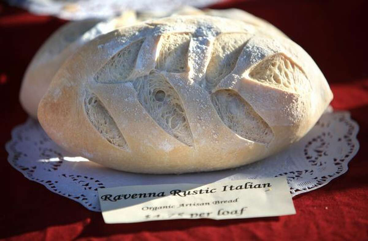 Rustic Italian loaf from Grateful Bread Bakery is for sale during the Olympic Sculpture Park Farmers Market on Thursday, Aug. 19, 2010.