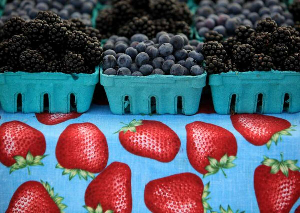 Berries from Jesse's Berries in Mount Vernon are for sale during the Olympic Sculpture Park Farmers Market.