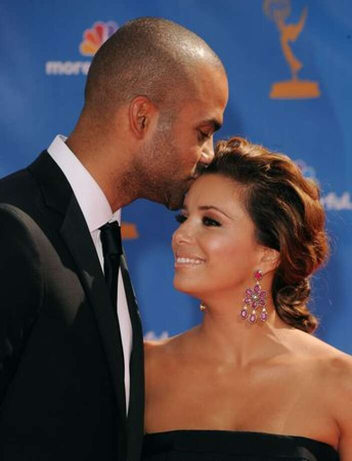 Actress Eva Longoria Parker (R) and husband Tony Parker arrive. Photo: Getty Images