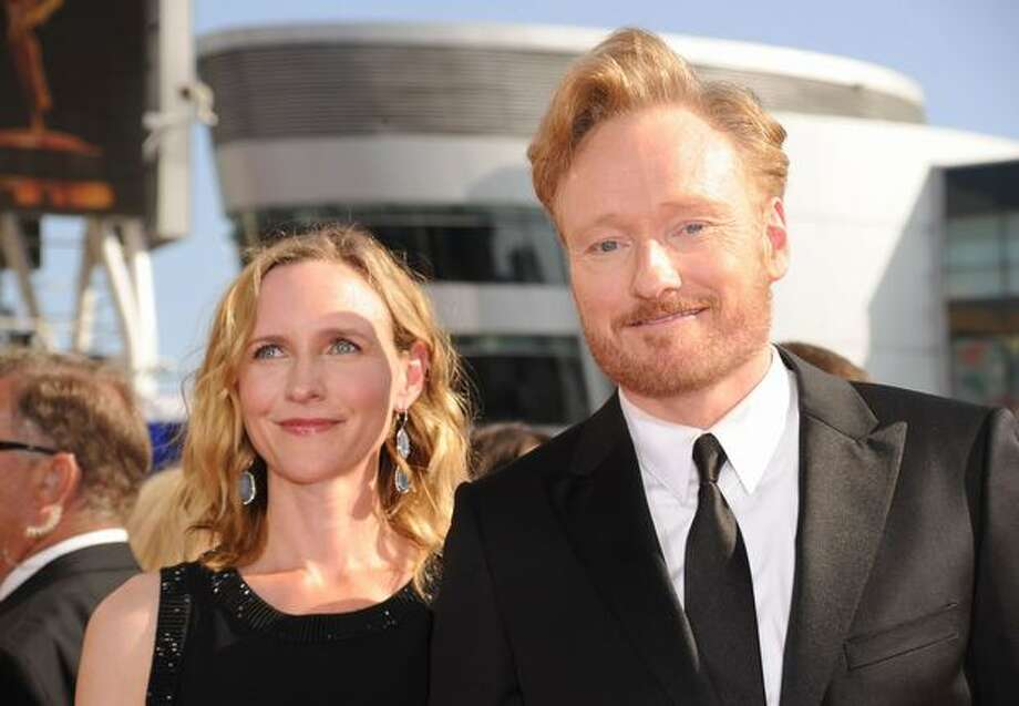 Conan O'Brien (R) and wife Liza Powell arrive. Photo: Getty Images