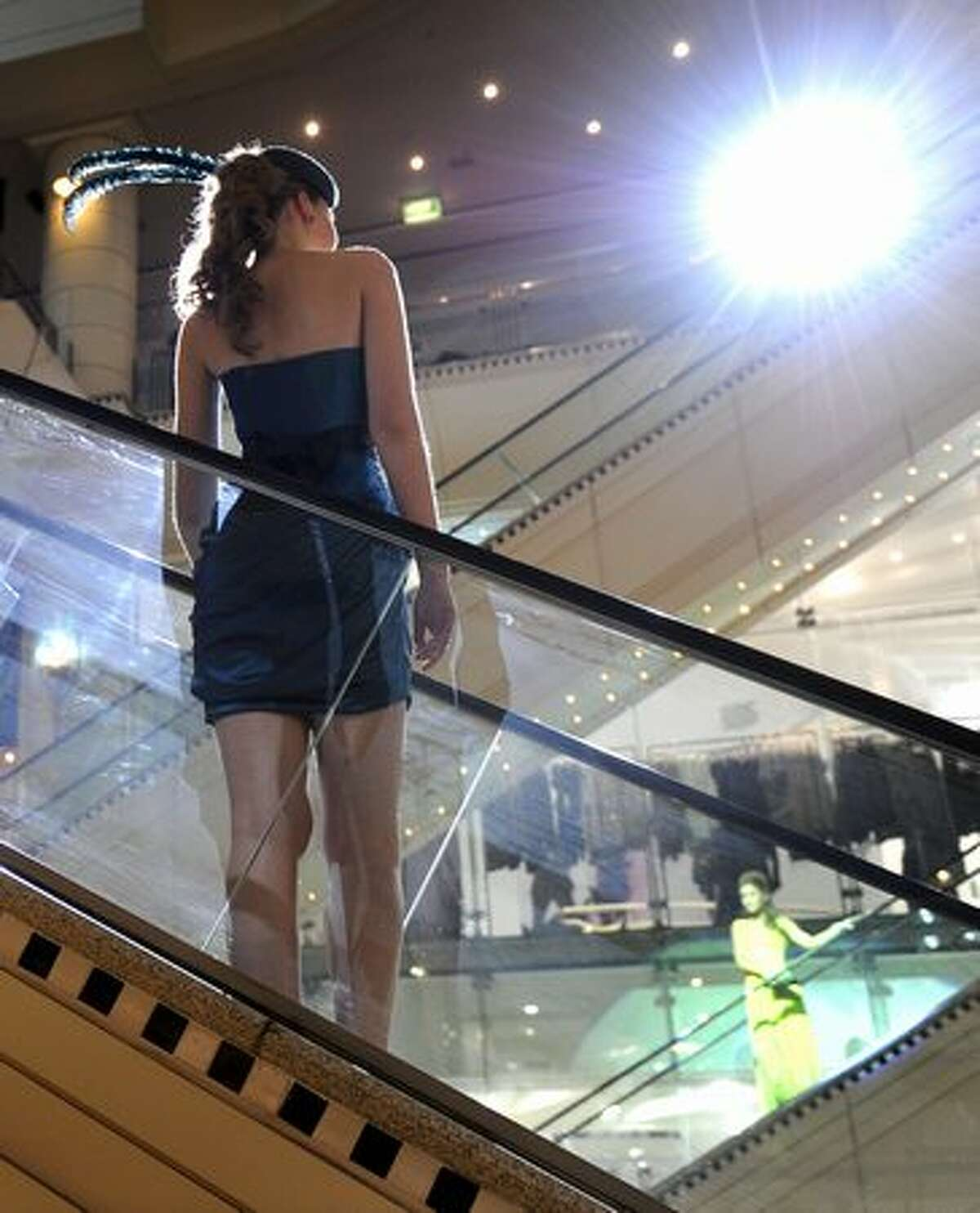 A model parades an outfit on an escalator during a show of designers at the Collins234 shopping complex.