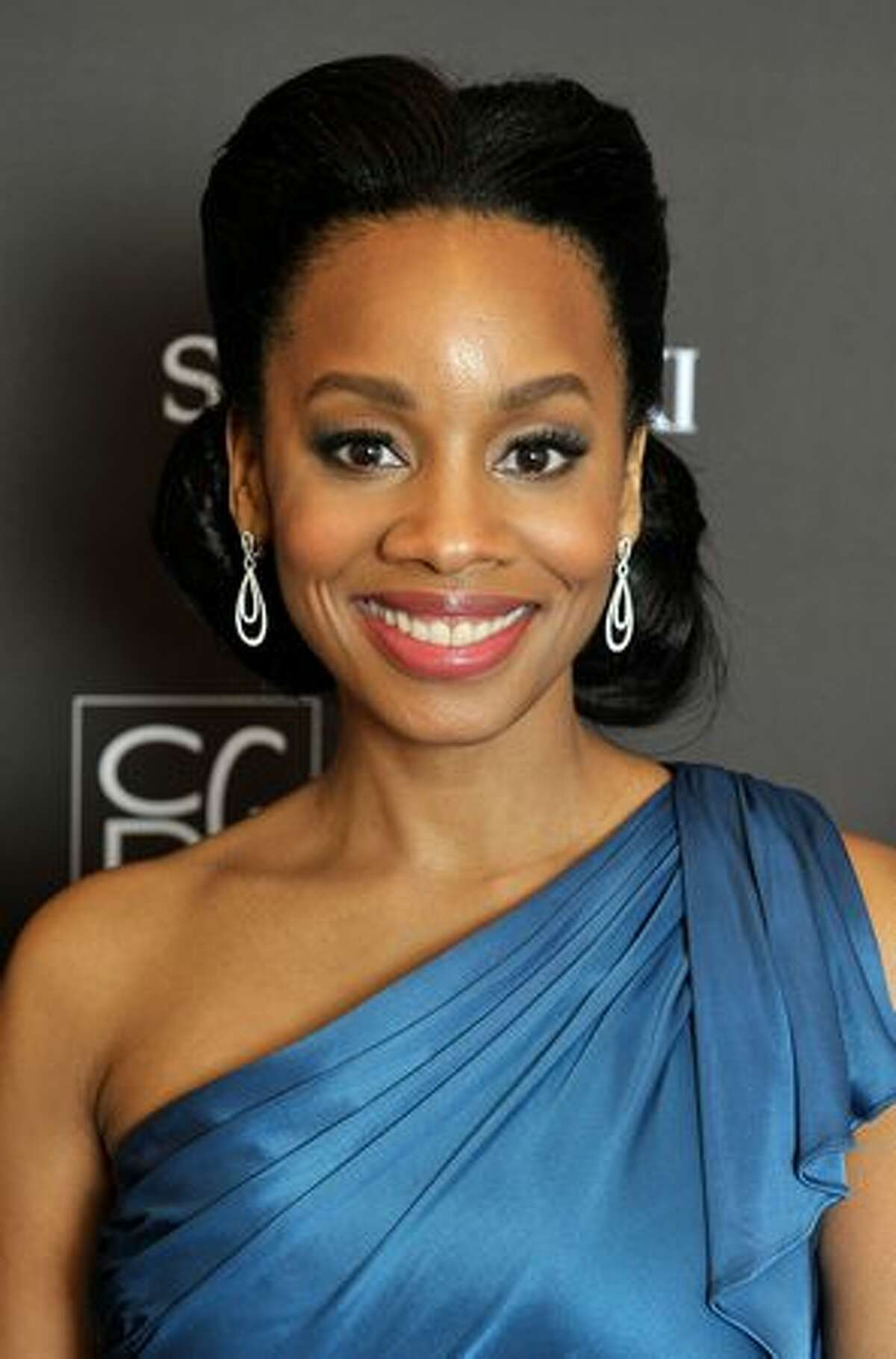 Actress Anika Noni Rose backstage during the 12th Annual Costume Designers Guild Awards with Presenting Sponsor Swarovski at The Beverly Hilton hotel in Beverly Hills, California.