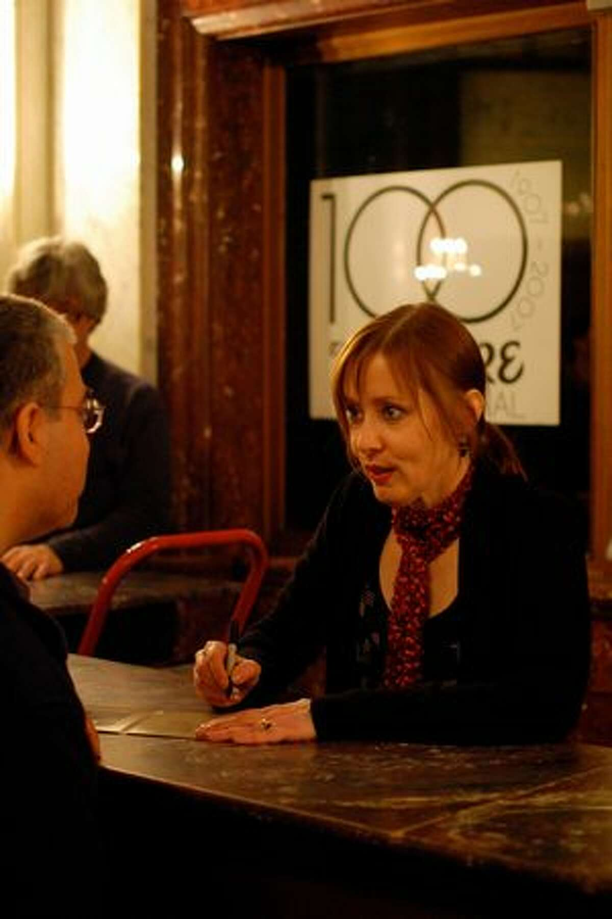 Suzanne Vega signing autographs after her performance at the Moore Theatre on Feb. 25. (Kam Martin / seattlepi.com)