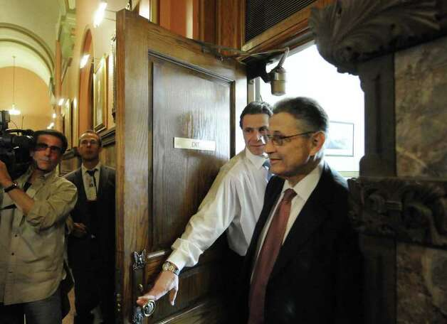 Governor Andrew Cuomo holds the door for Assembly Speaker Sheldon Silver following a meeting on the budget in his office at the Capitol in Albany Friday March 25, 2011.( Michael P. Farrell/Times Union ) Photo: Michael P. Farrell