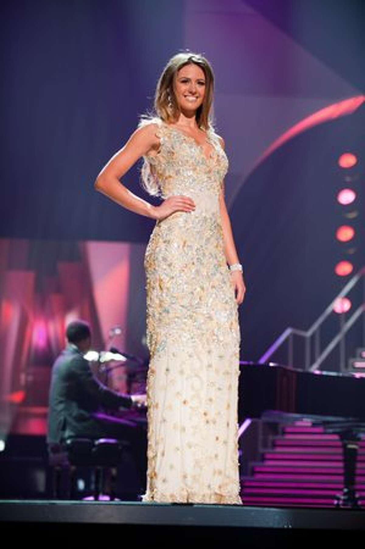 The 10 remaining contestants competed in evening gowns of their choice while musician John Legend performed. This is Jesinta Campbell, Miss Australia 2010, who scored 8.841 and advanced to the final five.