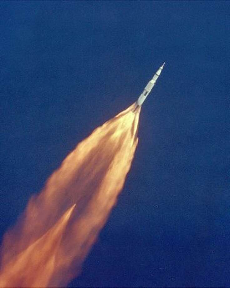"""The Apollo 11 Saturn V rocket climbs toward orbit after liftoff on July 16, 1969 from the Kennedy Space Center, Florida, carrying Neil Armstrong, Michael Collins and Edwin """"Buzz"""" Aldrin, Jr. on a mission tot he Moon. Photo: NASA"""