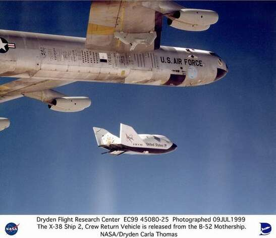 The X-38 research vehicle drops away from NASA's B-52 mothership  immediately after being released from the B-52's wing pylon in July 1999. The X-38 was a series of five research prototypes for a new, reusable space station crew return vehicle. It has since been cancelled. Photo: NASA / SL